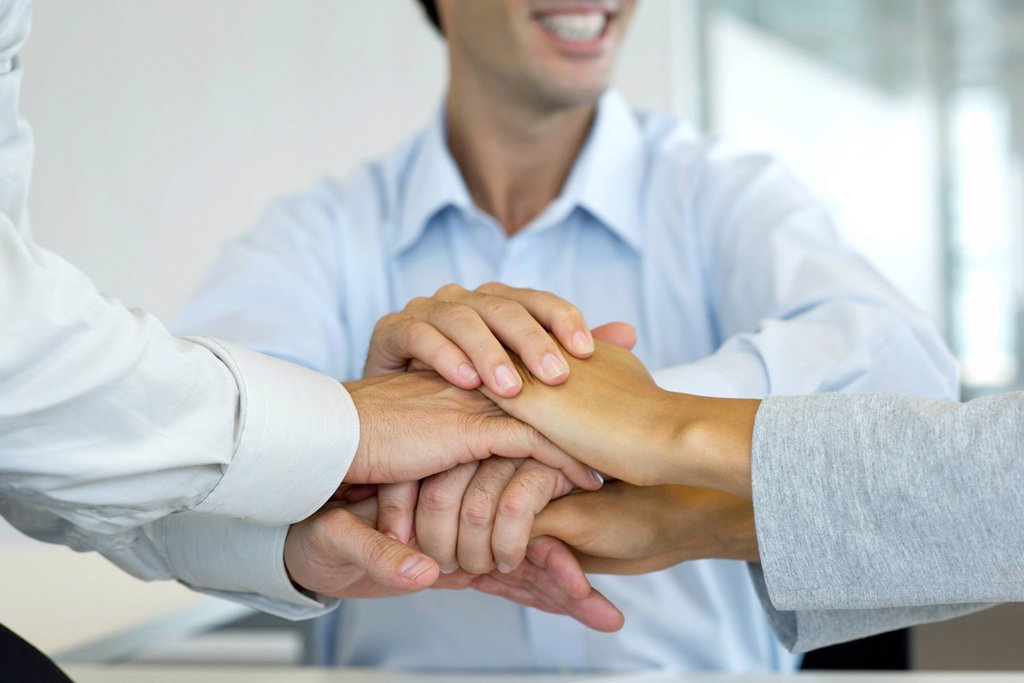 Stock Photo: 1569R-9070227 Business people stacking hands