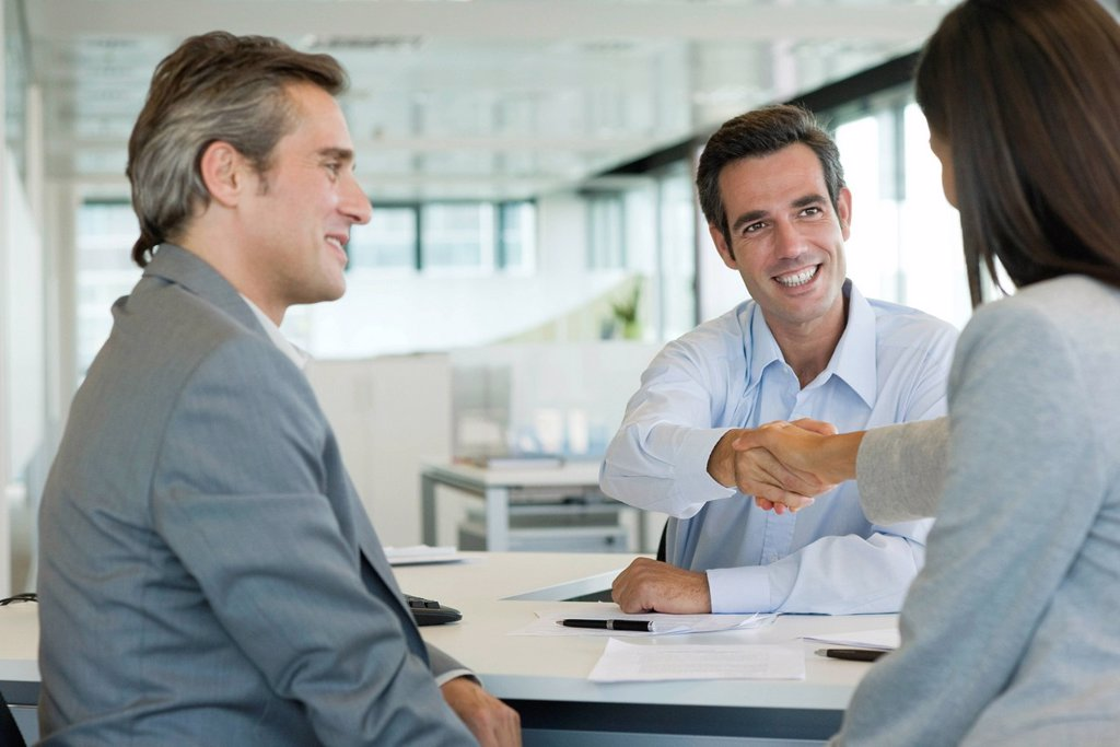 Stock Photo: 1569R-9070240 Businessman shaking hands with client