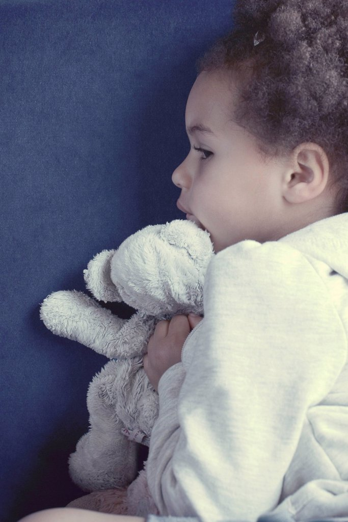 Little girl with stuffed toy : Stock Photo