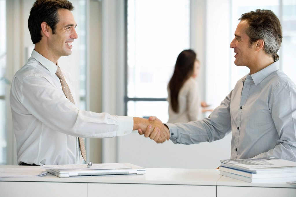Stock Photo: 1569R-9070365 Business partners shaking hands