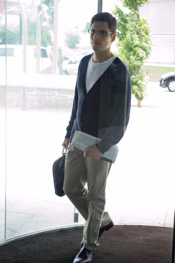 Businessman entering office building : Stock Photo