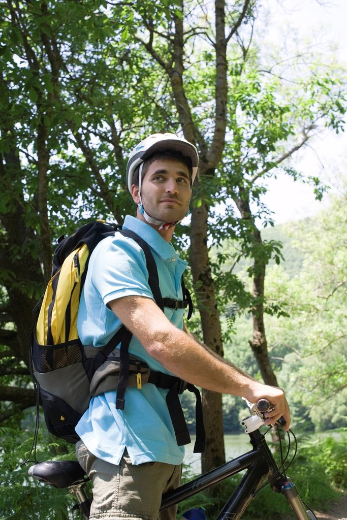 Stock Photo: 1569R-9070435 Man bike riding in woods
