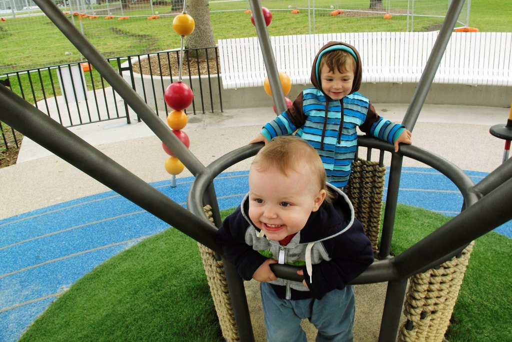 Stock Photo: 1569R-9070596 Toddler boys playing on playground