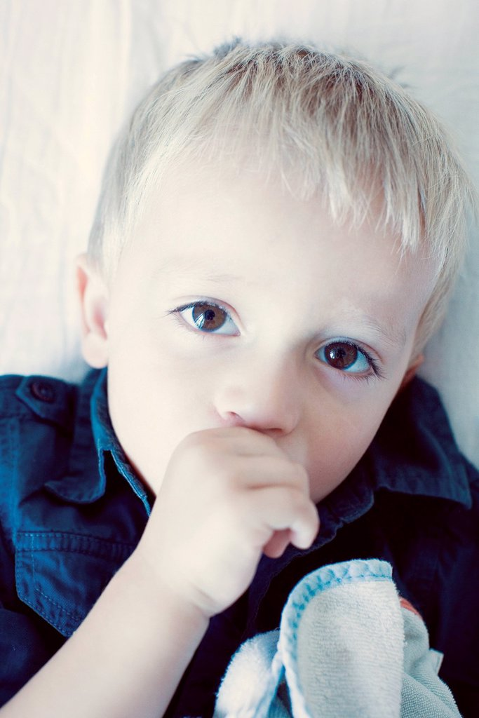 Stock Photo: 1569R-9070613 Little boy sucking his thumb, portrait