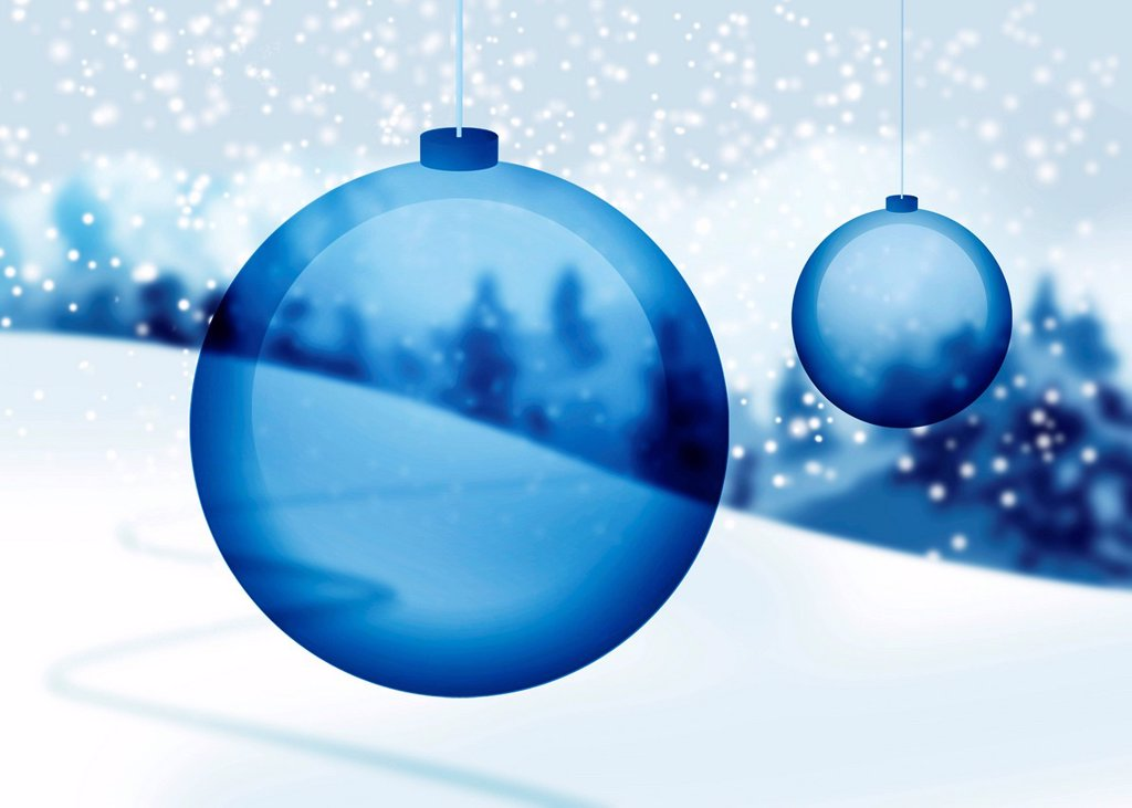 Transparent blue Christmas ornaments with snowy countryside in background : Stock Photo