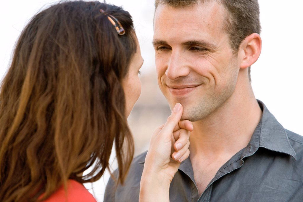 Woman caressing man´s chin : Stock Photo