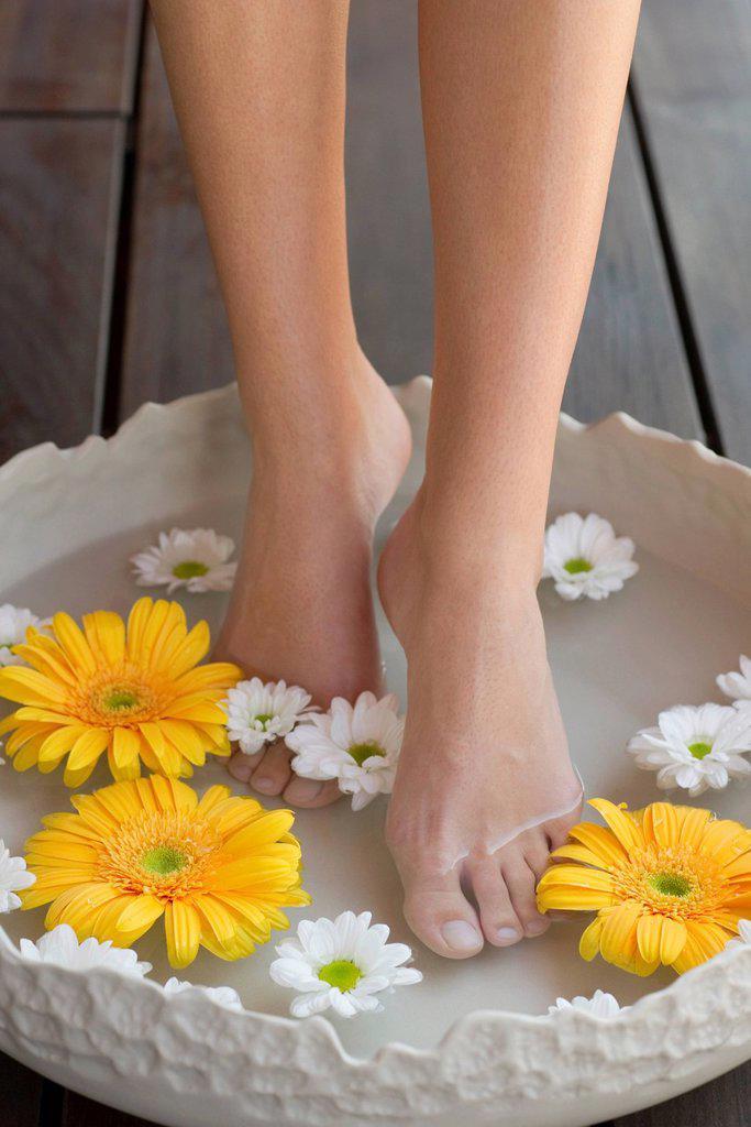 Stock Photo: 1569R-9070869 Woman enjoying relaxing foot bath