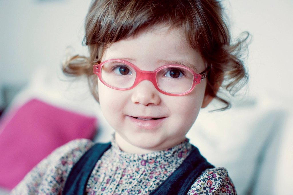 Little girl with glasses : Stock Photo