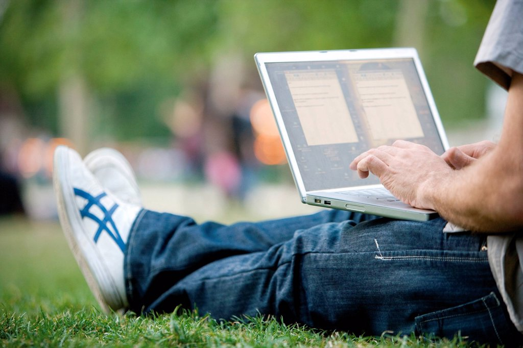 Man using laptop computer outdoors : Stock Photo