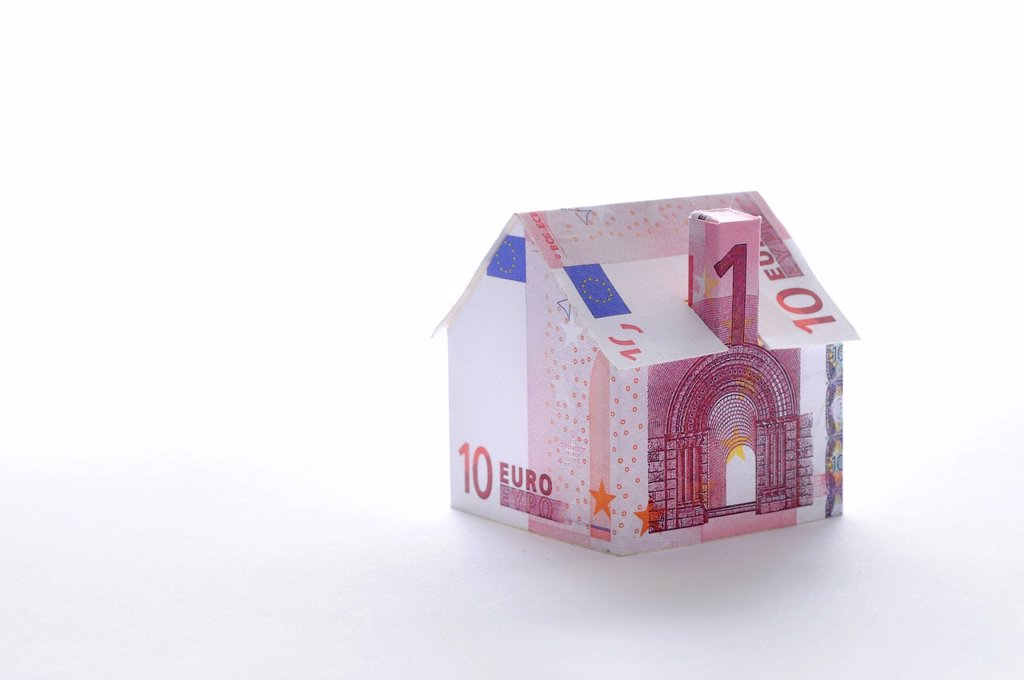 Model house folded with euro banknote : Stock Photo