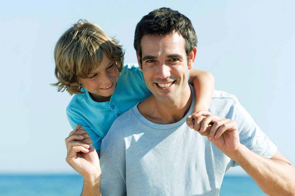 Father and son together outdoors, portrait : Stock Photo