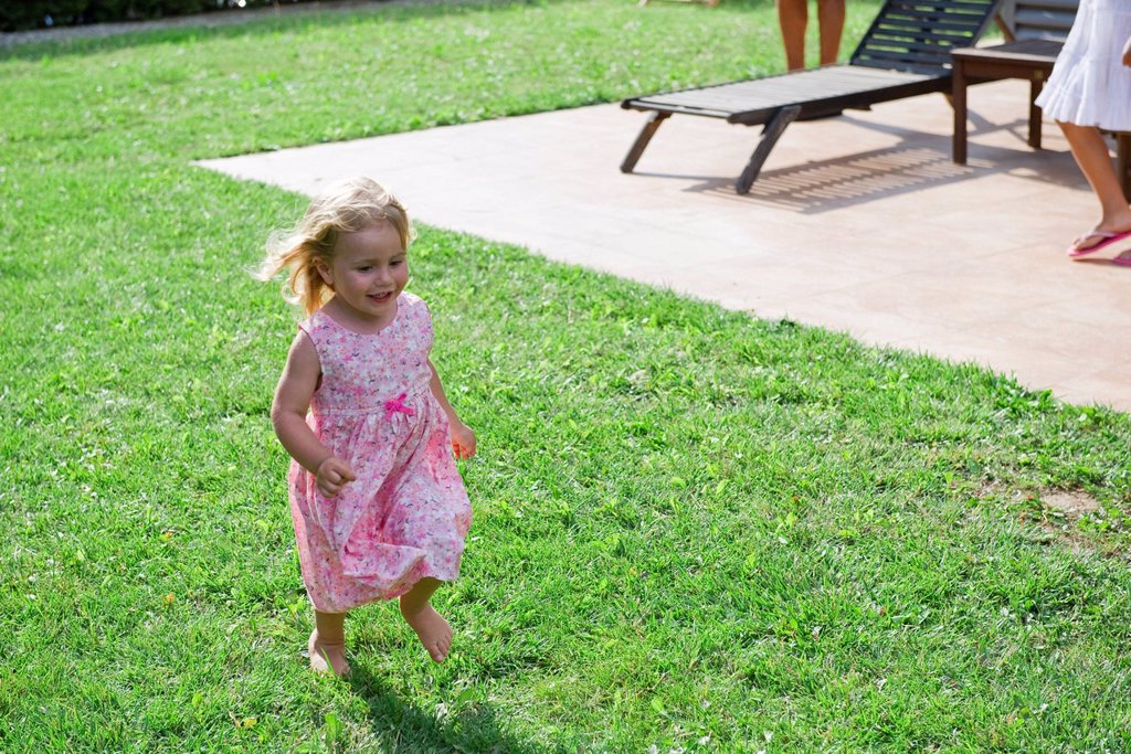 Stock Photo: 1569R-9071911 Little girl having fun outdoors