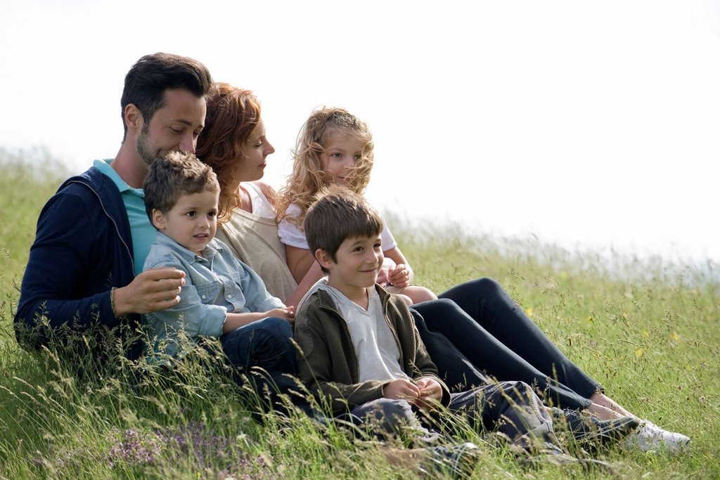 Family relaxing together outdoors : Stock Photo