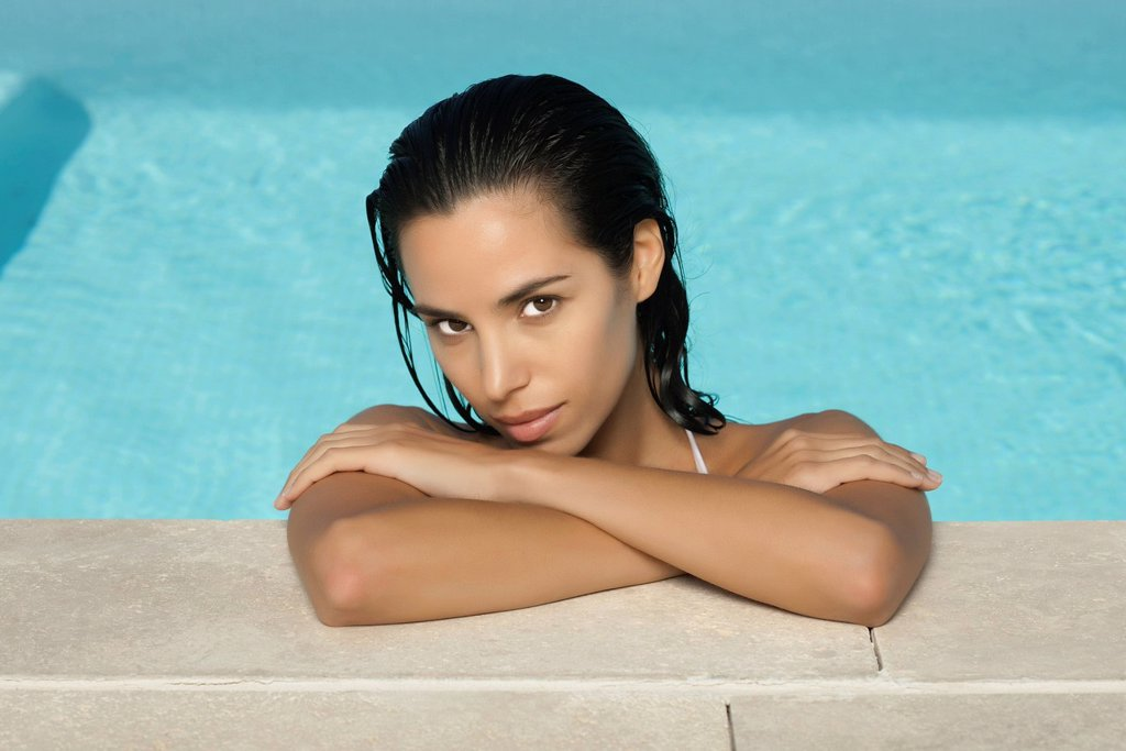 Stock Photo: 1569R-9072165 Woman relaxing in pool, portrait