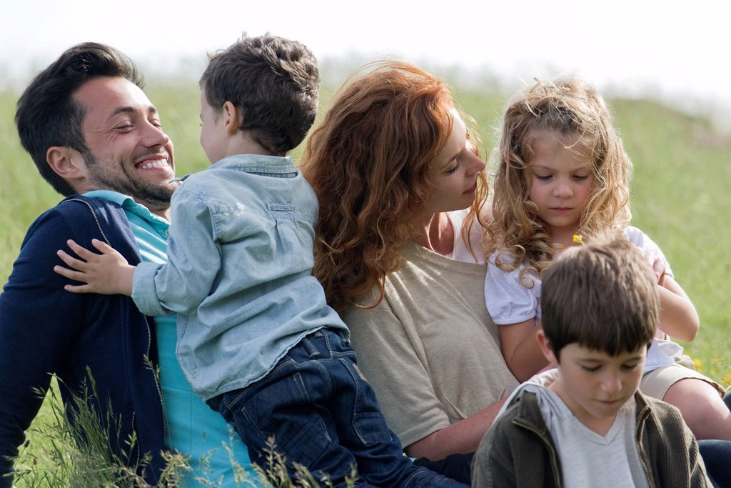 Family spending time together outdoors : Stock Photo