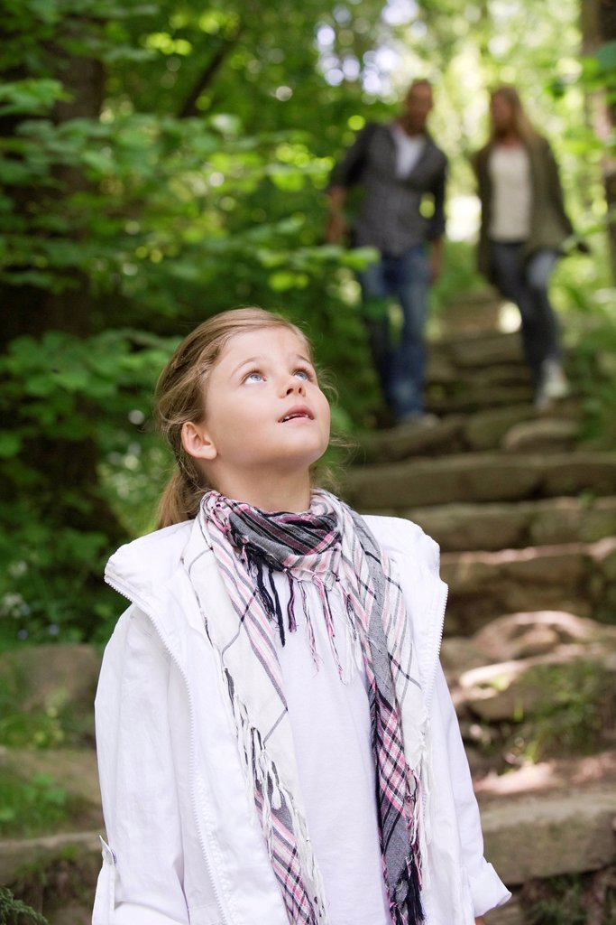 Stock Photo: 1569R-9072254 Girl in woods, looking up