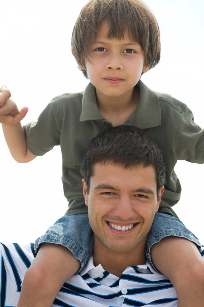 Boy riding on his father´s shoulders, portrait : Stock Photo