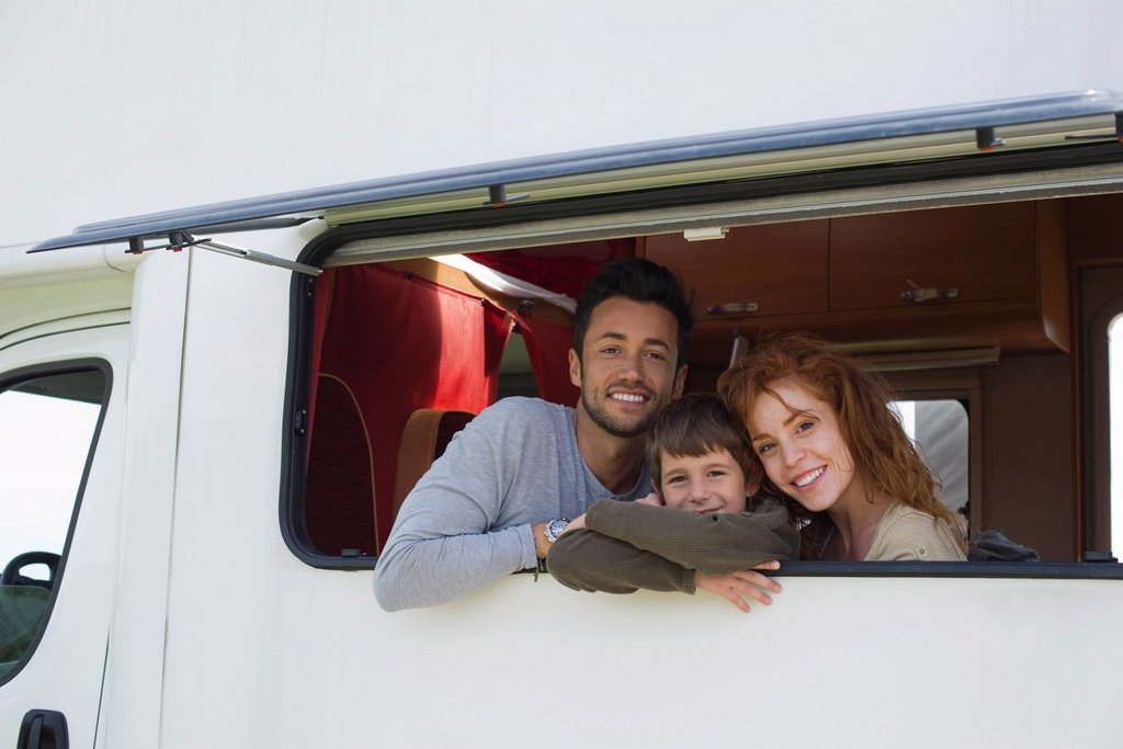 Stock Photo: 1569R-9072521 Parents and young boy in motor home, portrait