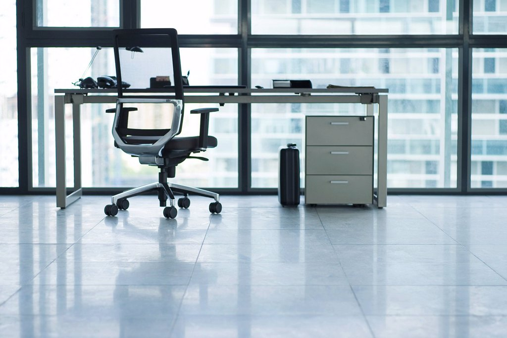 Desk and office chair in empty office : Stock Photo