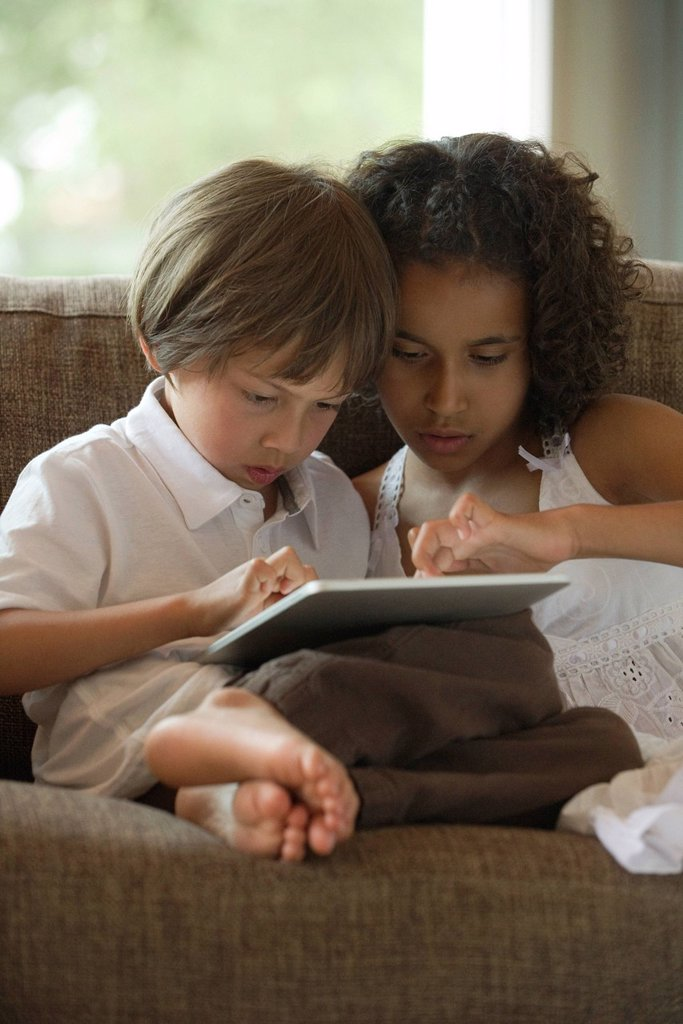 Chldren using digital tablet : Stock Photo