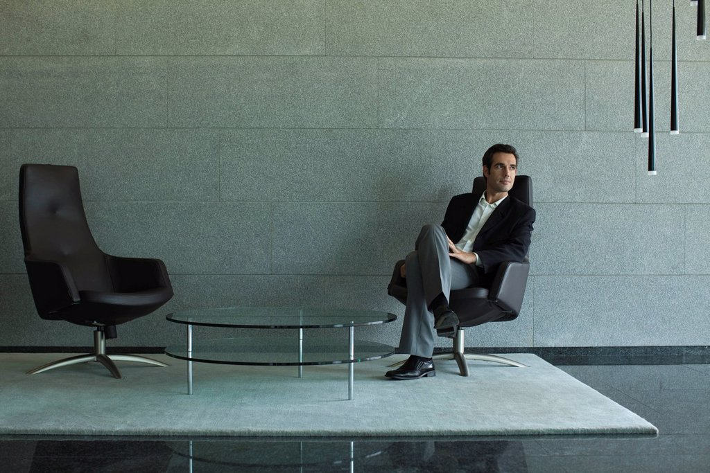 Executive sitting in lobby : Stock Photo
