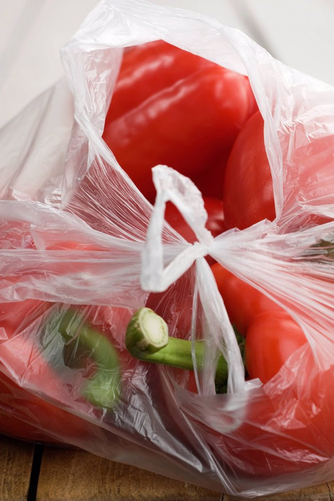 Red bell peppers in plastic bag : Stock Photo