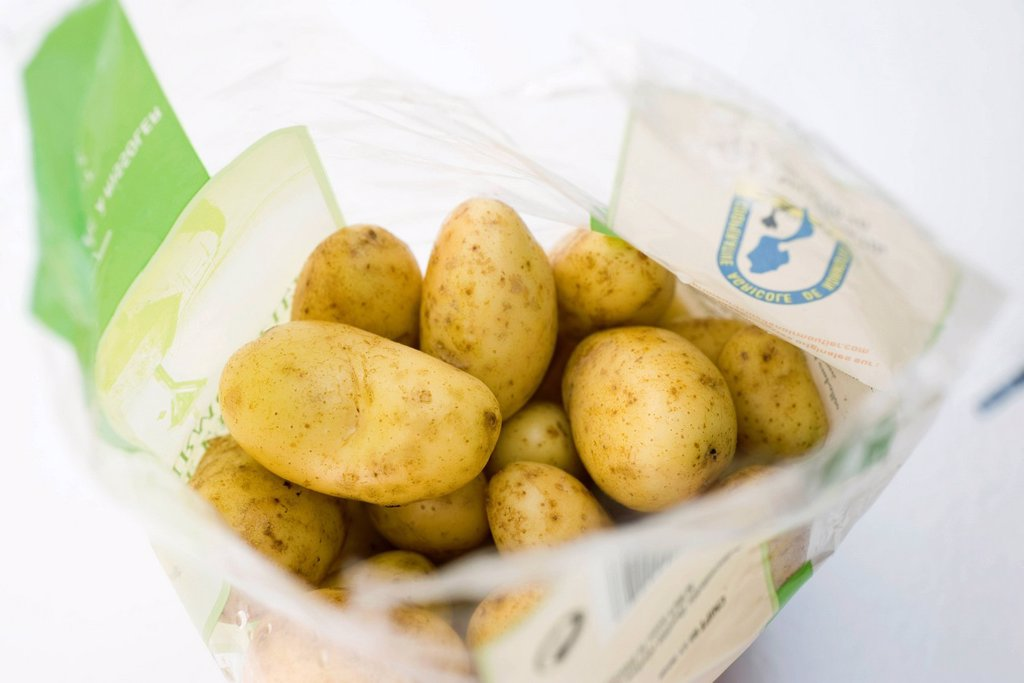Bag of potatoes : Stock Photo