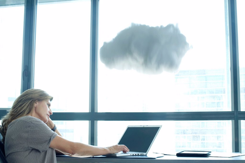 Woman using laptop computer. cloud above laptop computer : Stock Photo