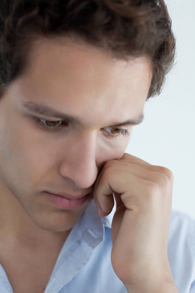 Stock Photo: 1569R-9073019 Man with sad expression