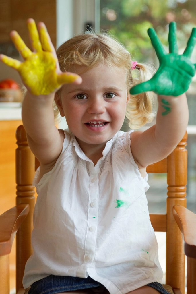 Little girl with paint on her hands : Stock Photo