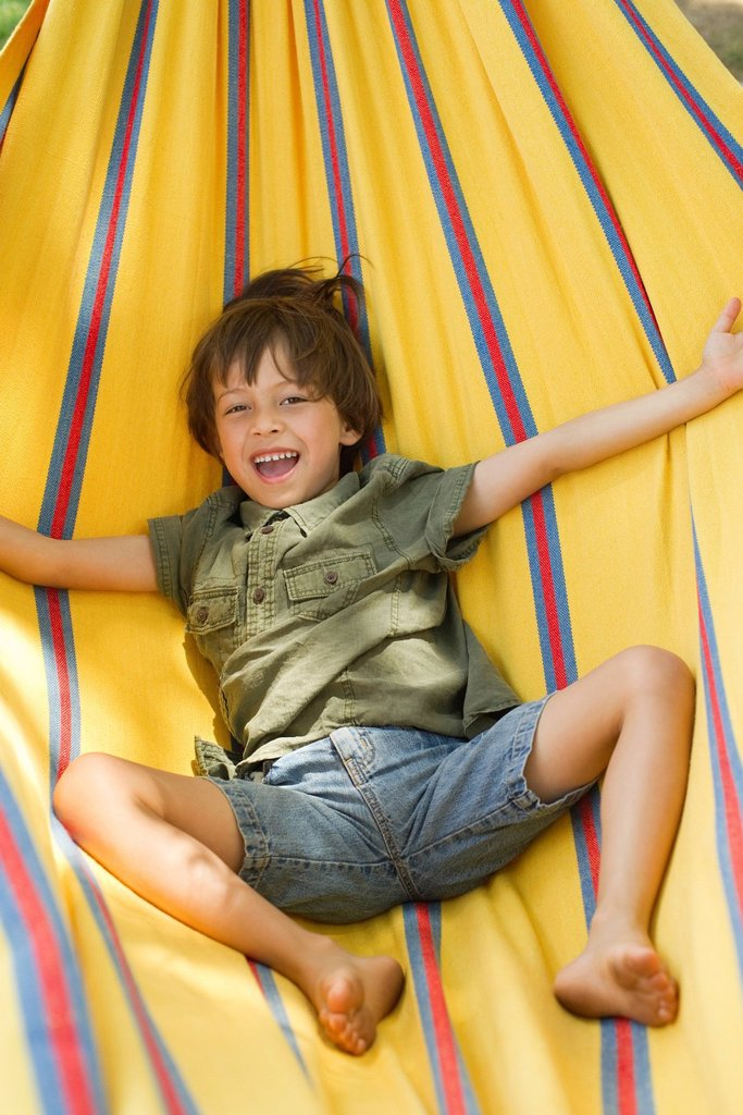 Stock Photo: 1569R-9073073 Boy lying in hammock, portrait