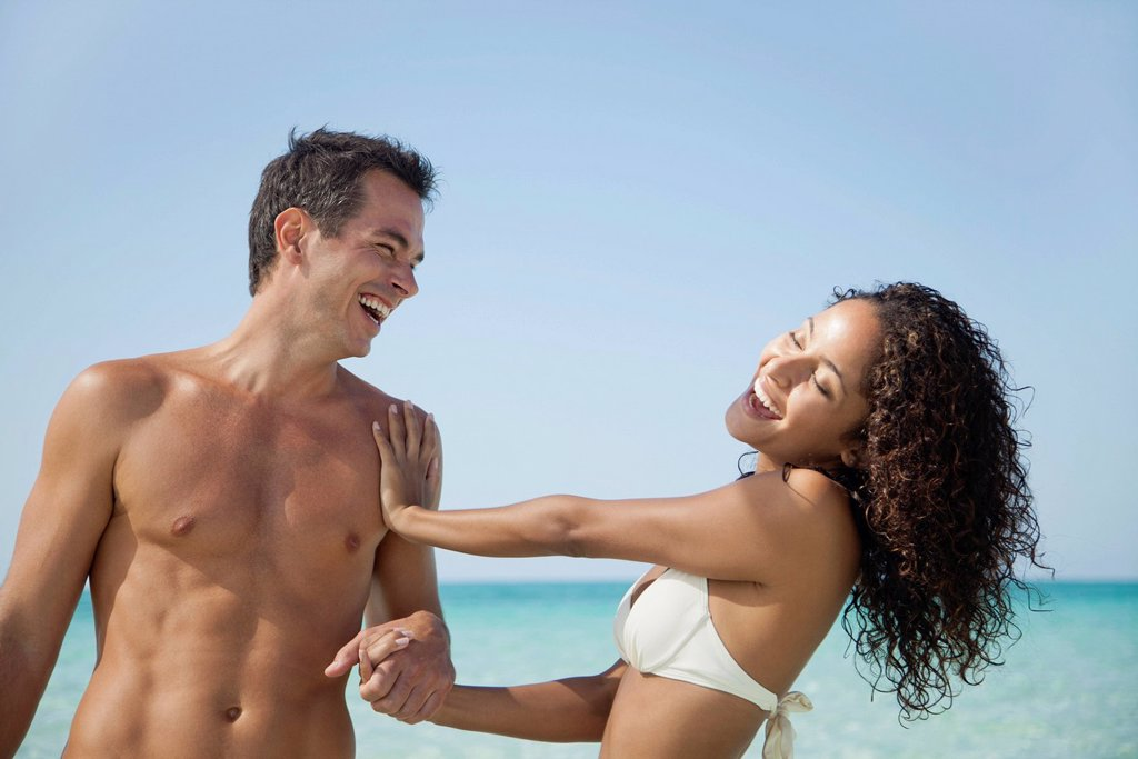 Couple having fun together at the beach : Stock Photo
