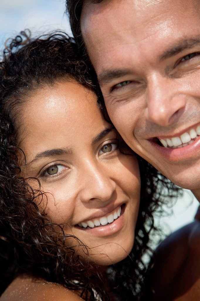 Stock Photo: 1569R-9073235 Couple cheek to cheek outdoors, portrait