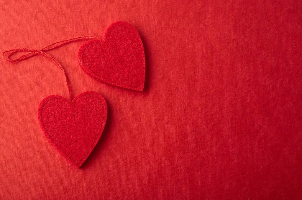 Stock Photo: 1569R-9073632 Heart ornaments on red background