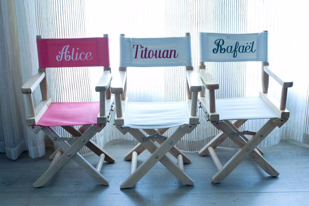 Director´s chairs with names embroidered on them : Stock Photo