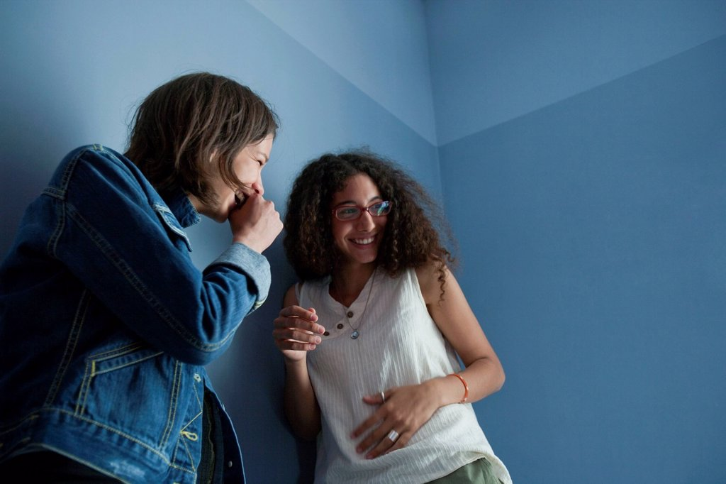 Young women laughing together : Stock Photo