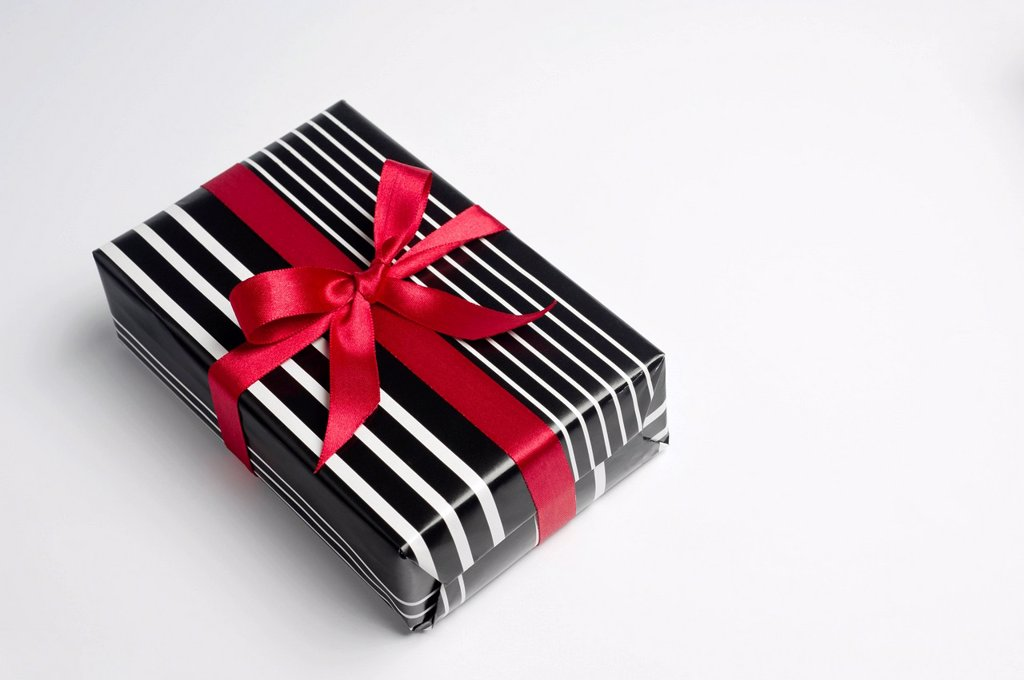 Festively wrapped gift : Stock Photo