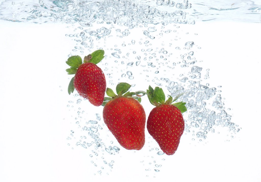 Strawberries submerged in water : Stock Photo