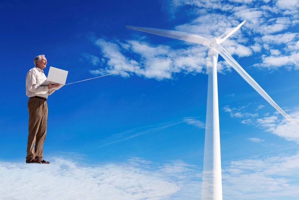 Stock Photo: 1569R-9074193 Man standing on cloud, using laptop computer powered by wind turbine