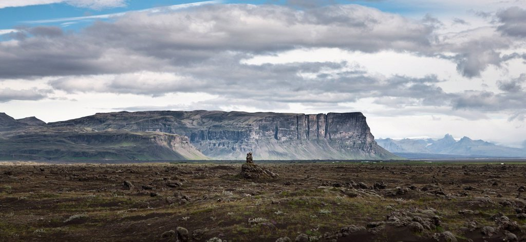 Stock Photo: 1569R-9074354 Iceland, panoramic view of lava field and cliffs
