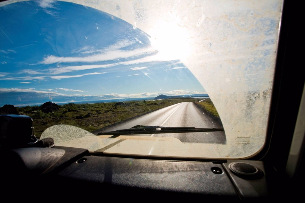 Stock Photo: 1569R-9074860 Country road viewed through car windshield