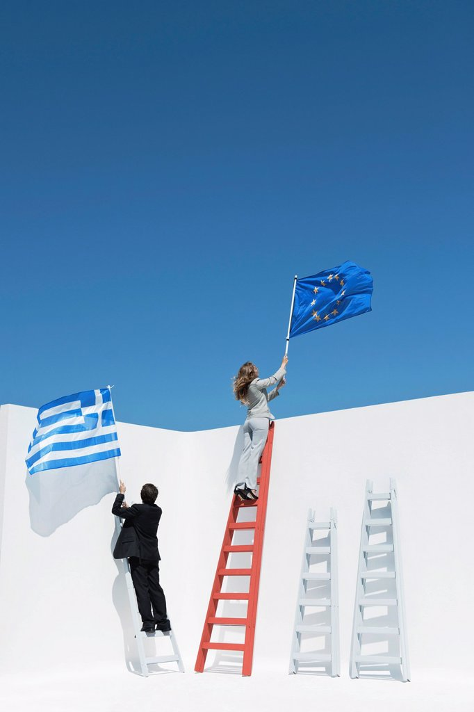 Stock Photo: 1569R-9075011 Executives climbing ladders, holding European Union flag and Greek flag to symbolize economic crisis