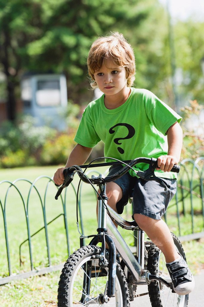 Stock Photo: 1569R-9075349 Boy riding bicycle