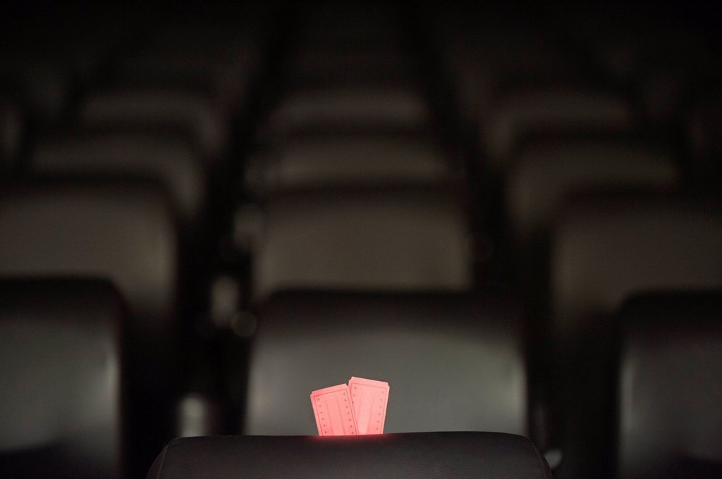 Stock Photo: 1569R-9075374 Movie tickets and empty seats in movie theater