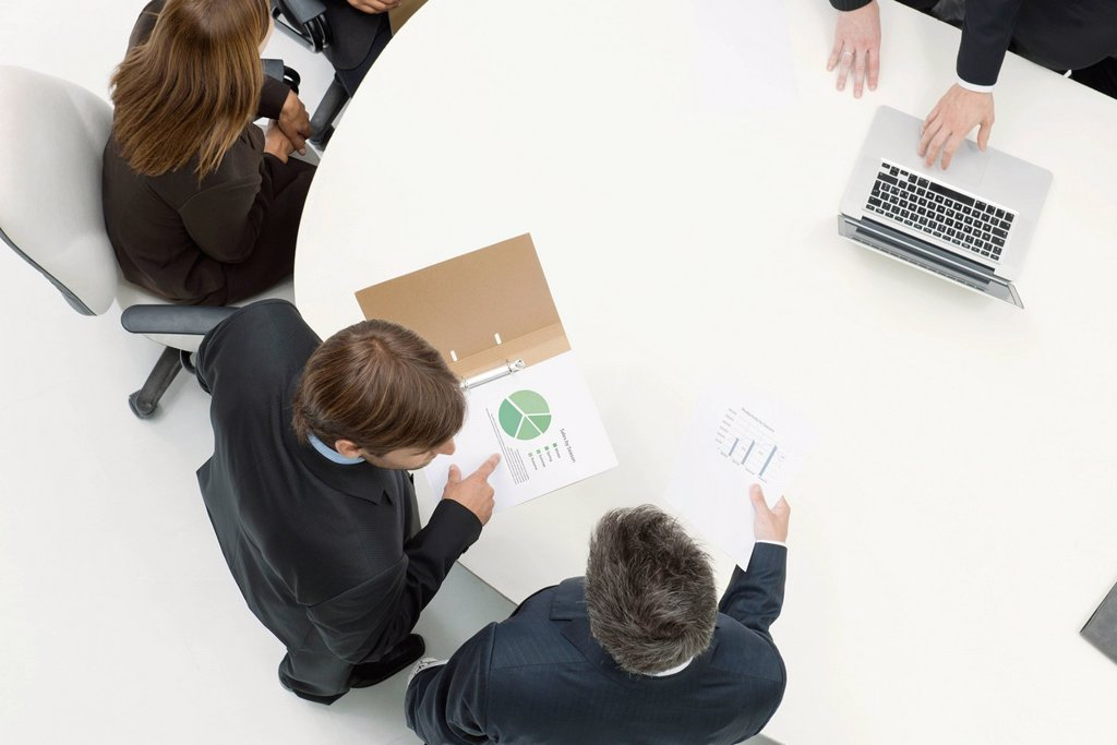 Business associates reviewing documents : Stock Photo