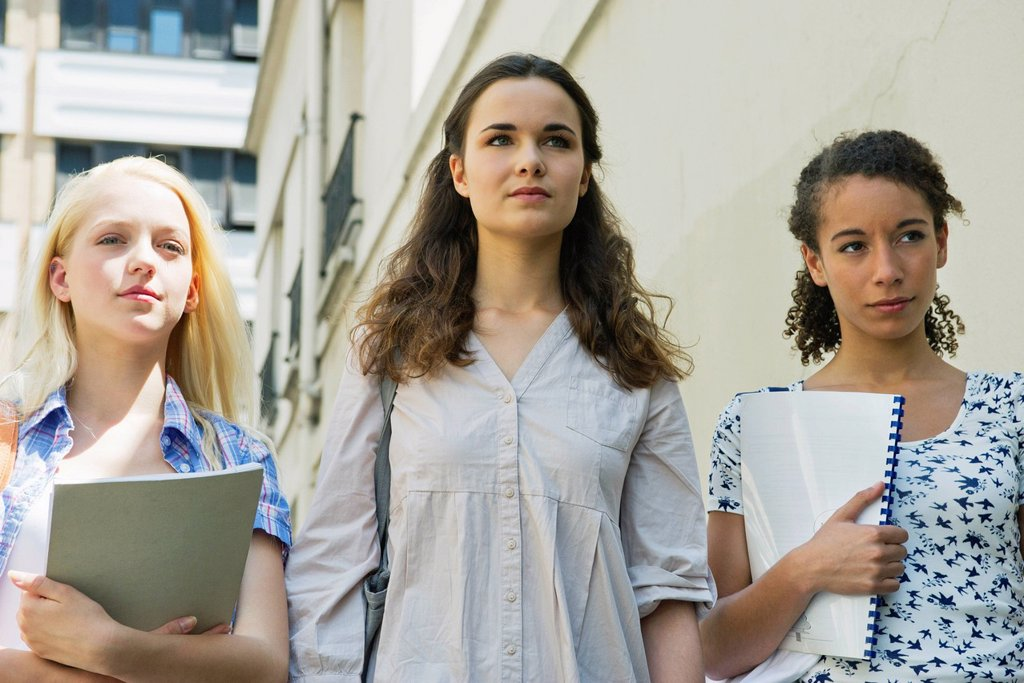 Female college students walking together outdoors : Stock Photo