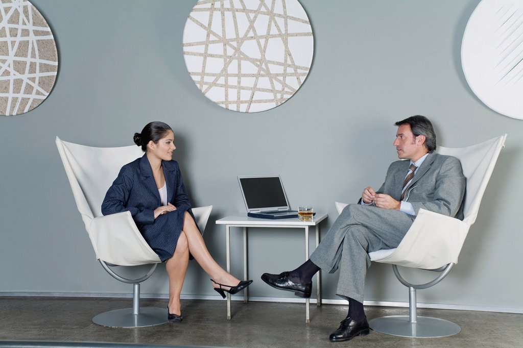 Stock Photo: 1569R-9076245 Businessman and businesswoman in meeting