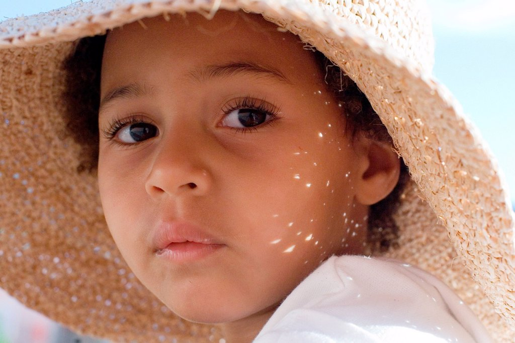 Little girl wearing sun hat, portrait : Stock Photo