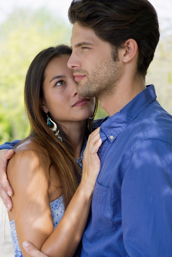 Young woman looking at boyfriend with admiration, portrait : Stock Photo