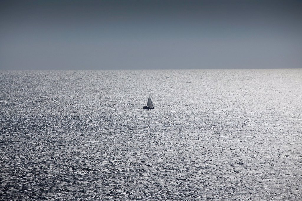 Stock Photo: 1569R-9077129 Solitary sailboat at sea